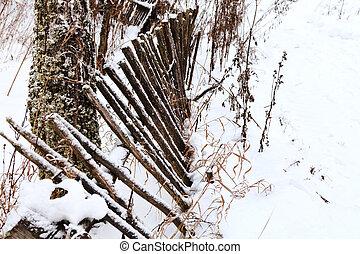 rickety wooden palisade in winter village