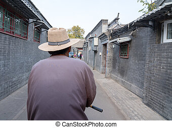 Rickshaw operator in Hutong district in Beijing