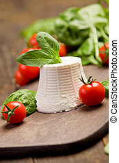 Ricotta Cheese - ricotta cheese with basil leaves and cherry...