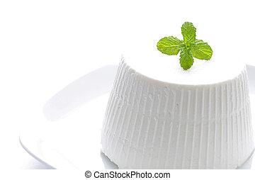 Fresh ricotta with basil leaf on white background