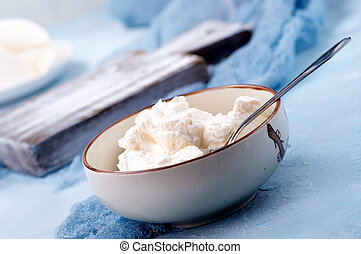 ricotta in bowl and on a table