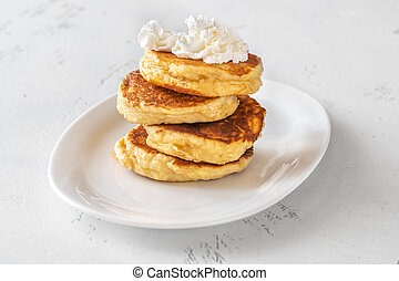 Ricotta pancakes - Stack of ricotta pancakes on the plate