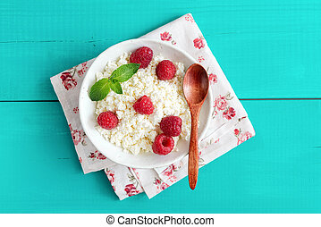 Ricotta with raspberries in a bowl