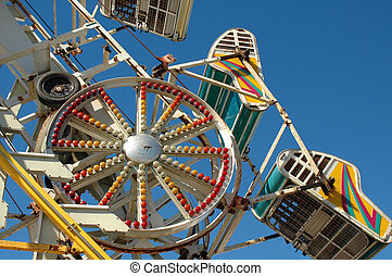 Ride at a County Fair - Whirling, twirling thrill ride at a ...