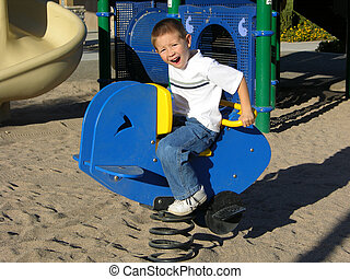 Boy riding toy at playground