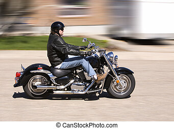 Ride - Man enjoying a motorcycle ride in the city (motion...