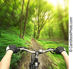 Ride - Mountain biking down hill descending fast on bicycle....