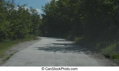 Ride on a Country Road - Driving the car on the bumpy...