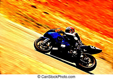 Racer rides motorcycle up hill.