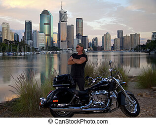 Rider - Bike rider with city of Brisbane (Australia) in the...