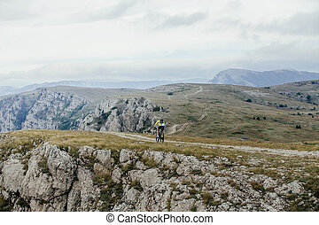rider cyclists on sport bike rides in mountains