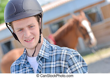 rider posing with a horse