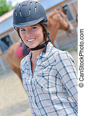rider posing with hat