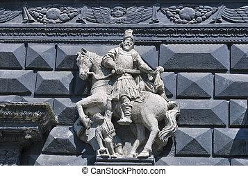 Rider sculpture on street wall in Lviv
