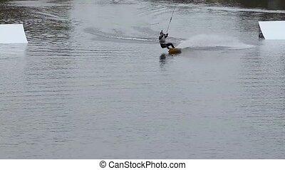 Rider wakeboard performs amplitude trick. Breathtaking...