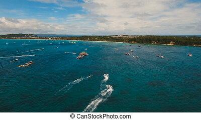 Riders on jet ski. Boracay island Philippines. - People...