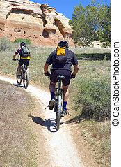 two mountain bike riders on Rustler's Loop near Loma, Colorado