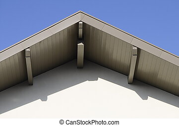 Ridge of a roof of a modern building, and blue sky