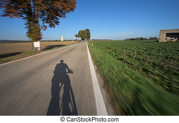 Riding a bicycle - Photo taken from a moving bicycle. Motion...