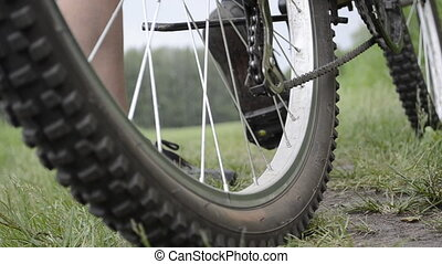Riding a bicycle. Wheels closeup