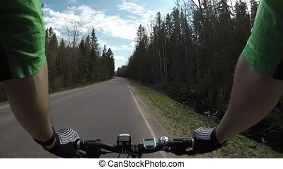 Riding a bike on the highway. First-person view. POV video.