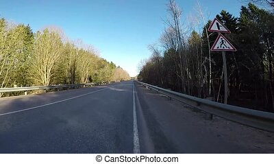 Riding a bike on the highway. First-person view. POV video