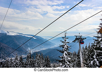 Riding a cable car in the mountains