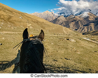 riding a horse first person view and a view of the mountains