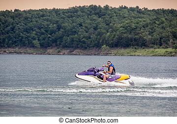 Riding a Jet ski.