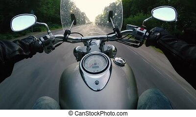 Riding a motorcycle. First-person view. Point of view.