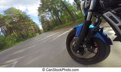 Riding a motorcycle, view on front wheel