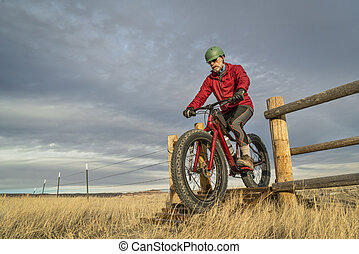 riding a mountain fat bike over cattle guard