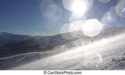 Riding at Ski Resort while Huge Blizzard at Sunny Day,...