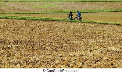 Riding Bicycle in the field