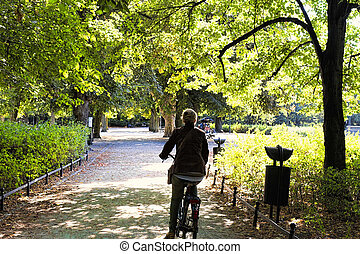 Riding bicycle in the park