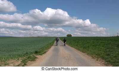 Riding Bike in Field