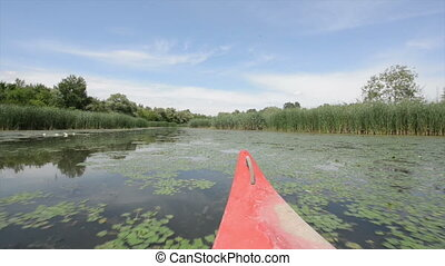 Riding canoe on the river angle shot