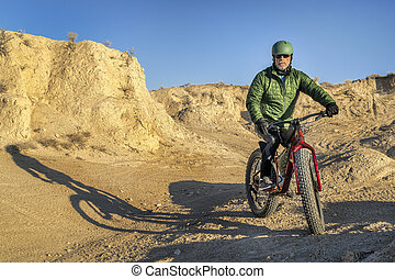 riding fat bike in badlands - Main Draw OHV Area in National...