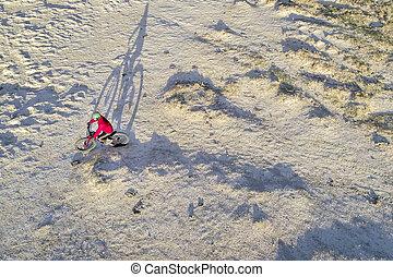 Riding fat bike on desert trail