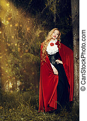 riding hood - Beautiful blonde woman in old-fashioned dress ...