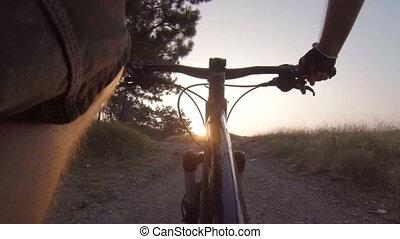 riding mountain bike at sunrise