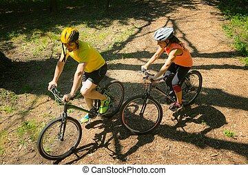 Riding mountain bikes