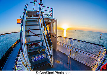 riding on a ferry boat at sunset