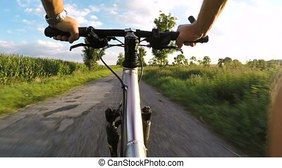Riding on a MRB bike (Bicycle) in summer evening countryside