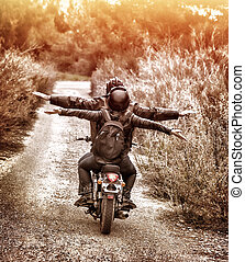 Riding on motorbike with pleasure - Vintage style image, ...
