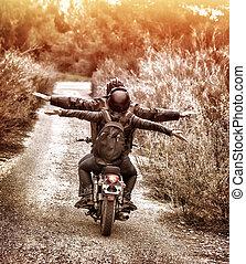 Riding on motorbike with pleasure - Vintage style image, ...