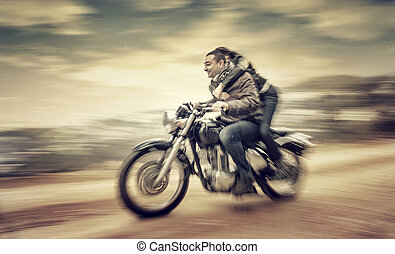 Riding on motorcycle - Two happy people riding on motorcycle...