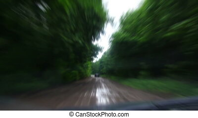 Riding on muddy forest road - timelapse