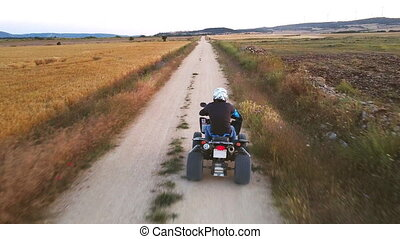 Riding quad bike. Man in protective equipment and helmet, ...