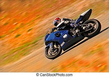 Riding Saturn - A lightening quick motorcycle rider speeds...
